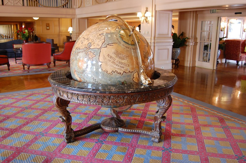 """A giant globe featuring a """"Hidden Mickey"""" in the lobby of Disney's Yacht Club Resort."""