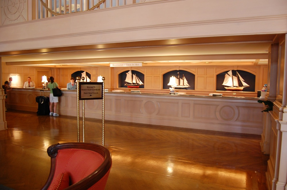 Check-in & Registration Desk at Disney's Yacht Club Resort.