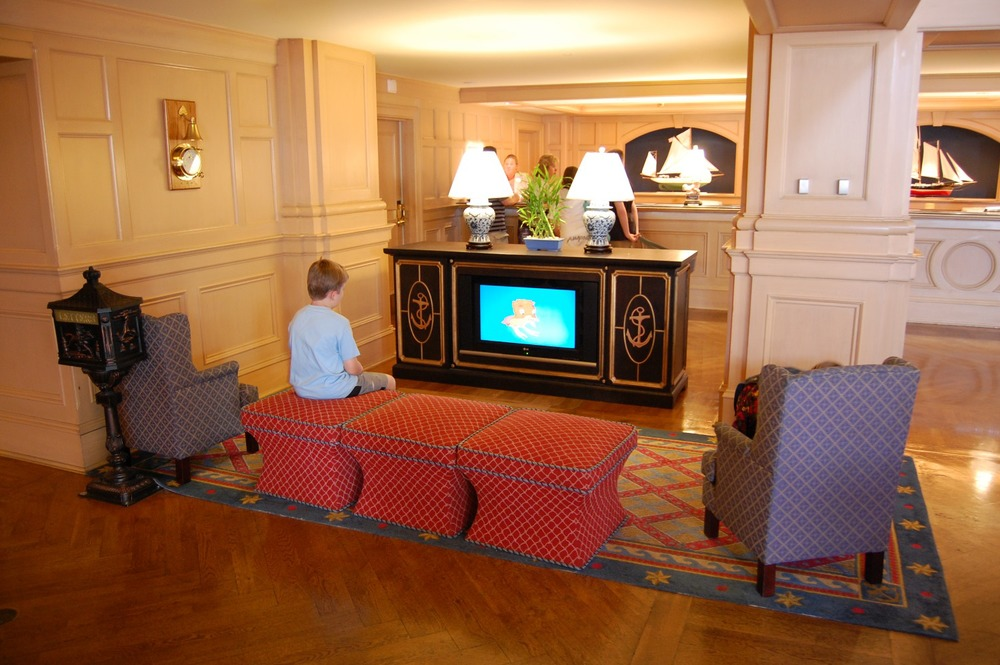 There's a kid-sized spot for watching Disney cartoons in the lobby of the Yacht Club hotel - Walt Disney World Resort.