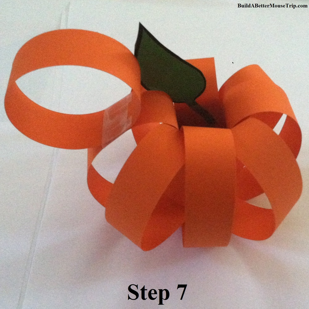 Step 7 - Make Mickey Mouse ears for your pumpkin from 2 strips of orange construction paper.