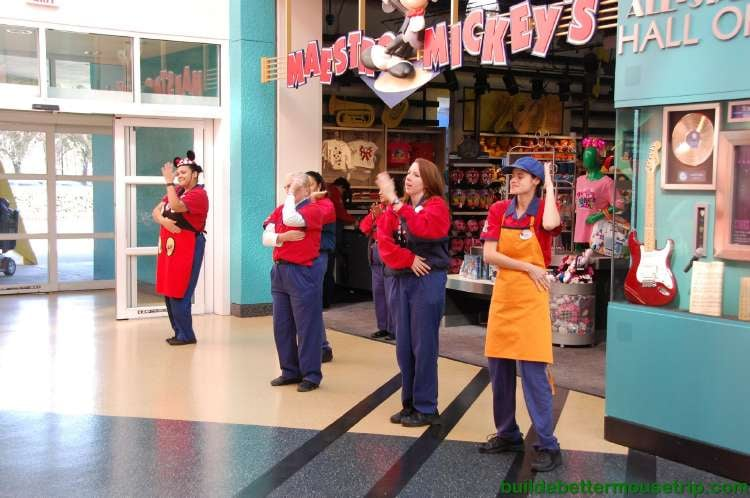 Cast members doing the macarena in the lobby of Disney's All-Star Music Resort