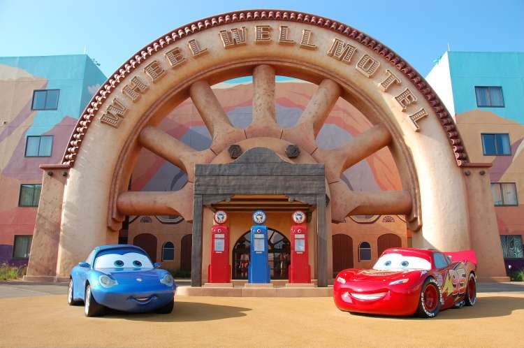 Art-of-Animation-510-Lightning-McQueen-and-Sally-in-front-of-the-Wheel-Well-Motel-at-Disneys-Art-of-Animation-Resort.JPG