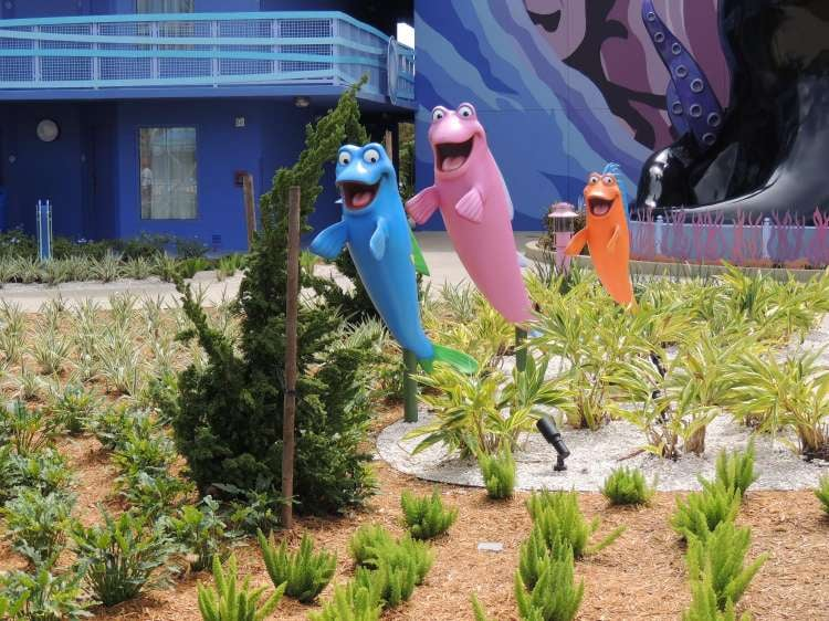 Art-of-Animation-733-Little-Mermaid-Courtyard-conga-line-fish.JPG