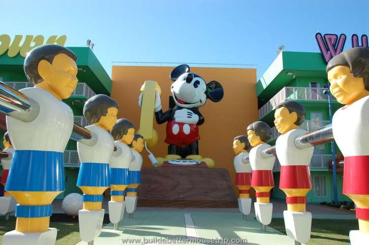 Giant Mickey Mouse phone and Foos-ball statues in the courtyard of the '70s area at Disney's Pop Century Resort