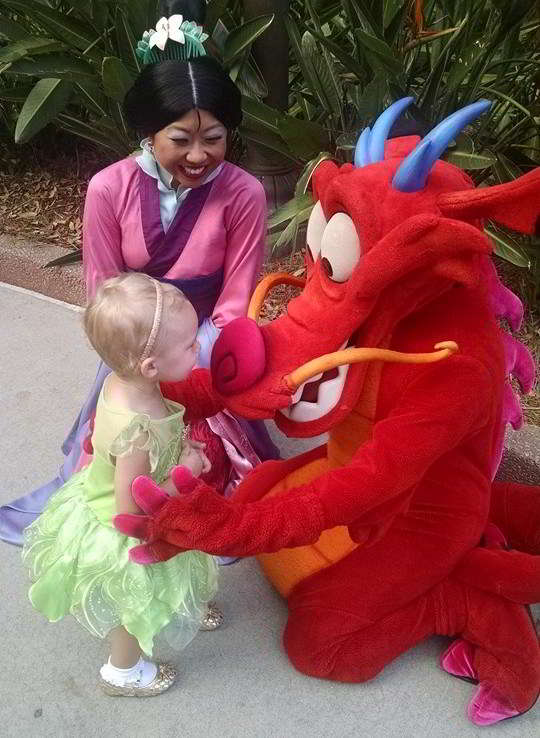 A Guide to Epcot with Kids - Mulan and Mushu greet guests, sign autographs and pose for pictures in the China Pavilion at Epcot.