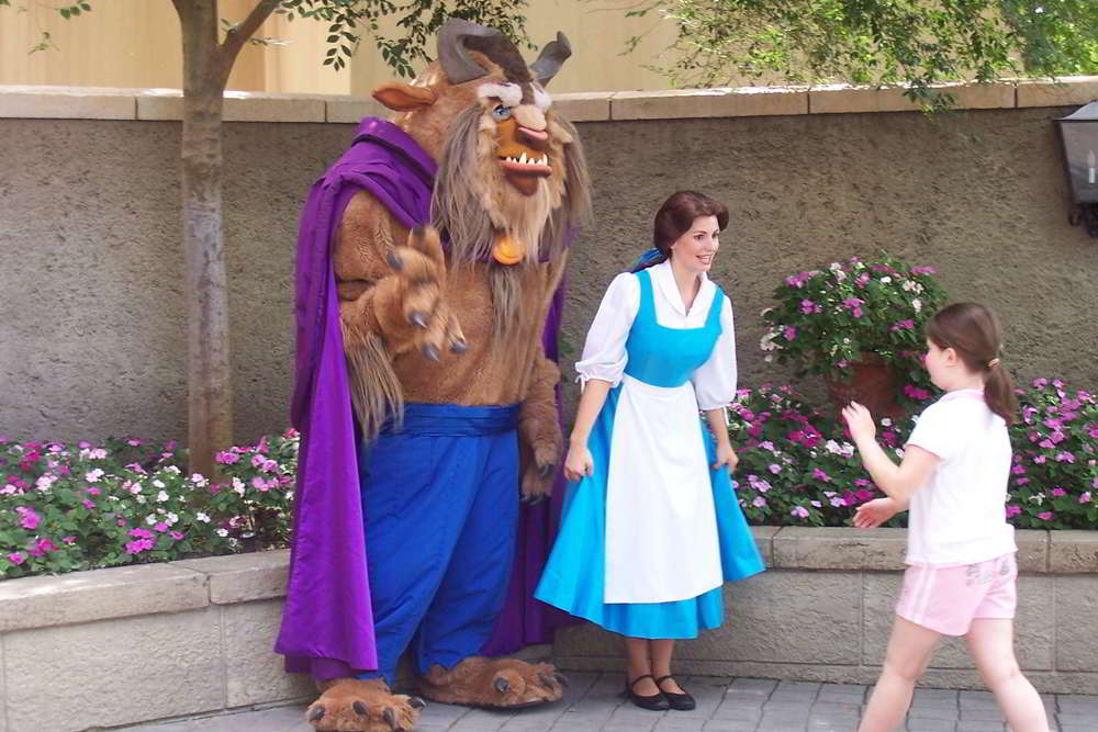 Belle and the Beast meet guests in the France Pavilion at Epcot.