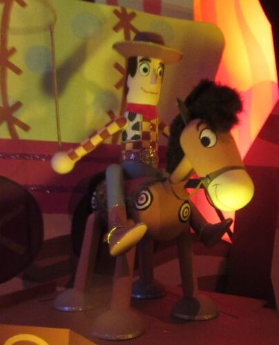 "Woody & Bullseye from Toy Story.   ""it's a small world"" at Disneyland has stylized versions of Disney characters tucked into the displays."