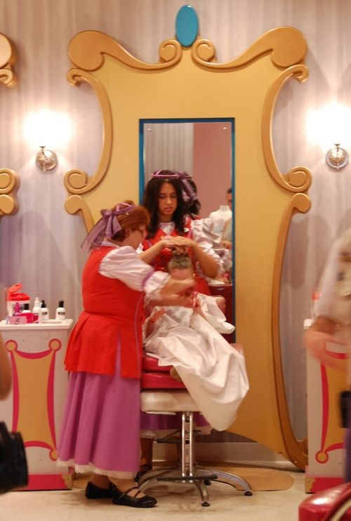 Fairy Godmothers hard at work on a princes makeover in the  Bibbidi Bobbidi Boutique at Walt Disney World Resort.