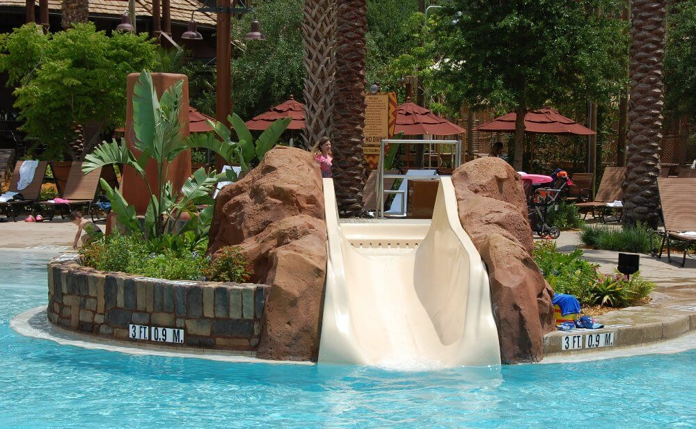 Children's slide  IN THE zero-depth entry pool at the  SAMAWATI SPRINGS POOL COMPLEX AT DISNEY'S ANIMAL KINGDOM LODGE - ZIDANI VILLAGE - ONE OF THE BEST SPLASH ZONES OF THE DISNEY WORLD HOTELS, DELUXE RESORT CATEGORY.