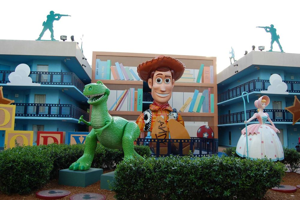 Woody in front of a Toy Story Building at Disney's All-Star Movies Resort