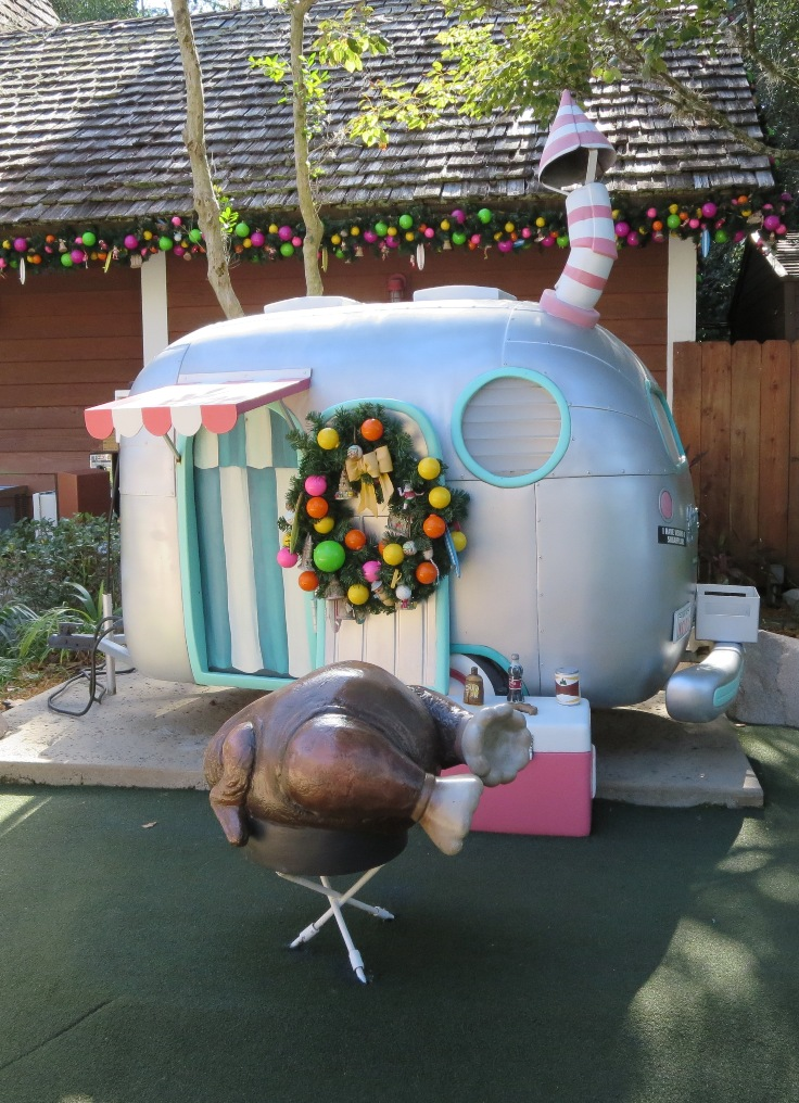 I love this scene with a full turkey being cooked over a little barbecue grill in front of a tiny trailer from Disney's Winter Summerland miniature golf course.