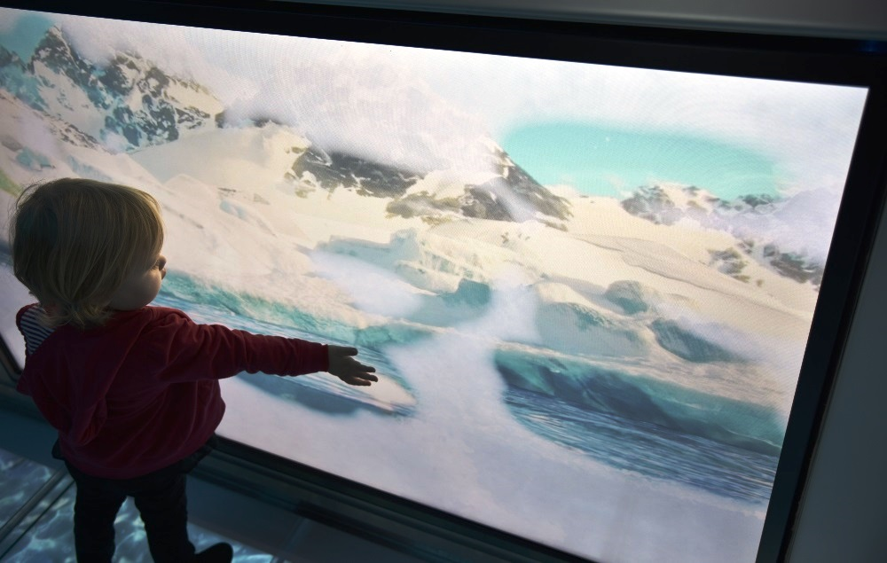 Interactive touch screens keep little ones occupied while you wait to meet the Coca-Cola polar bear at the Coca-Cola Store in Disney Springs
