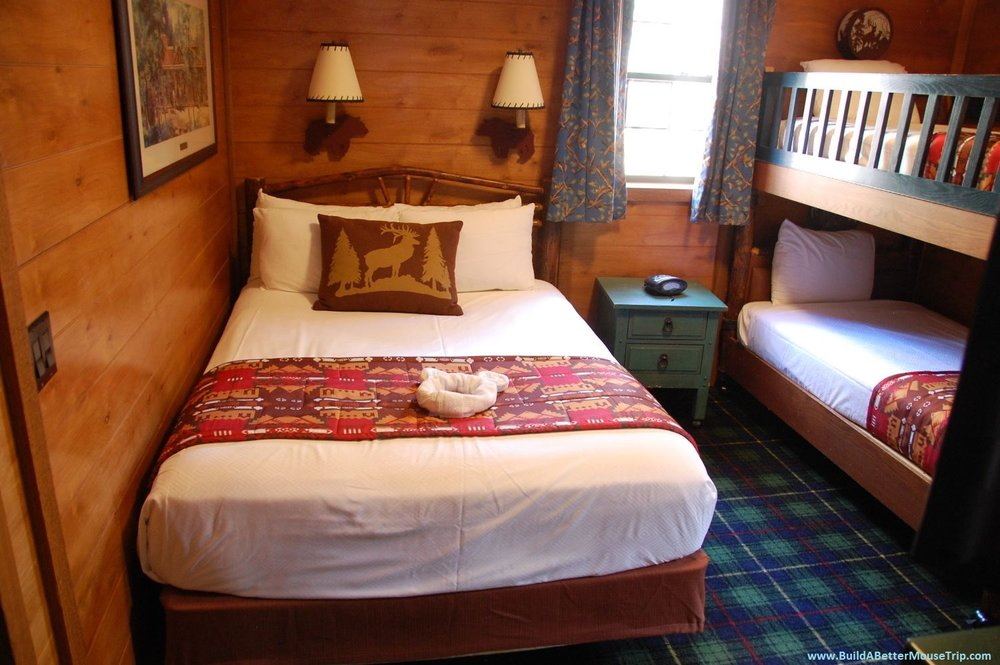 The bedroom in the cabins at Disney's Fort Wilderness Resort & Campground can sleep up to four guests; two more can sleep on the Murphy bed in the main living area for a total of six adults + up to one baby in a crib.