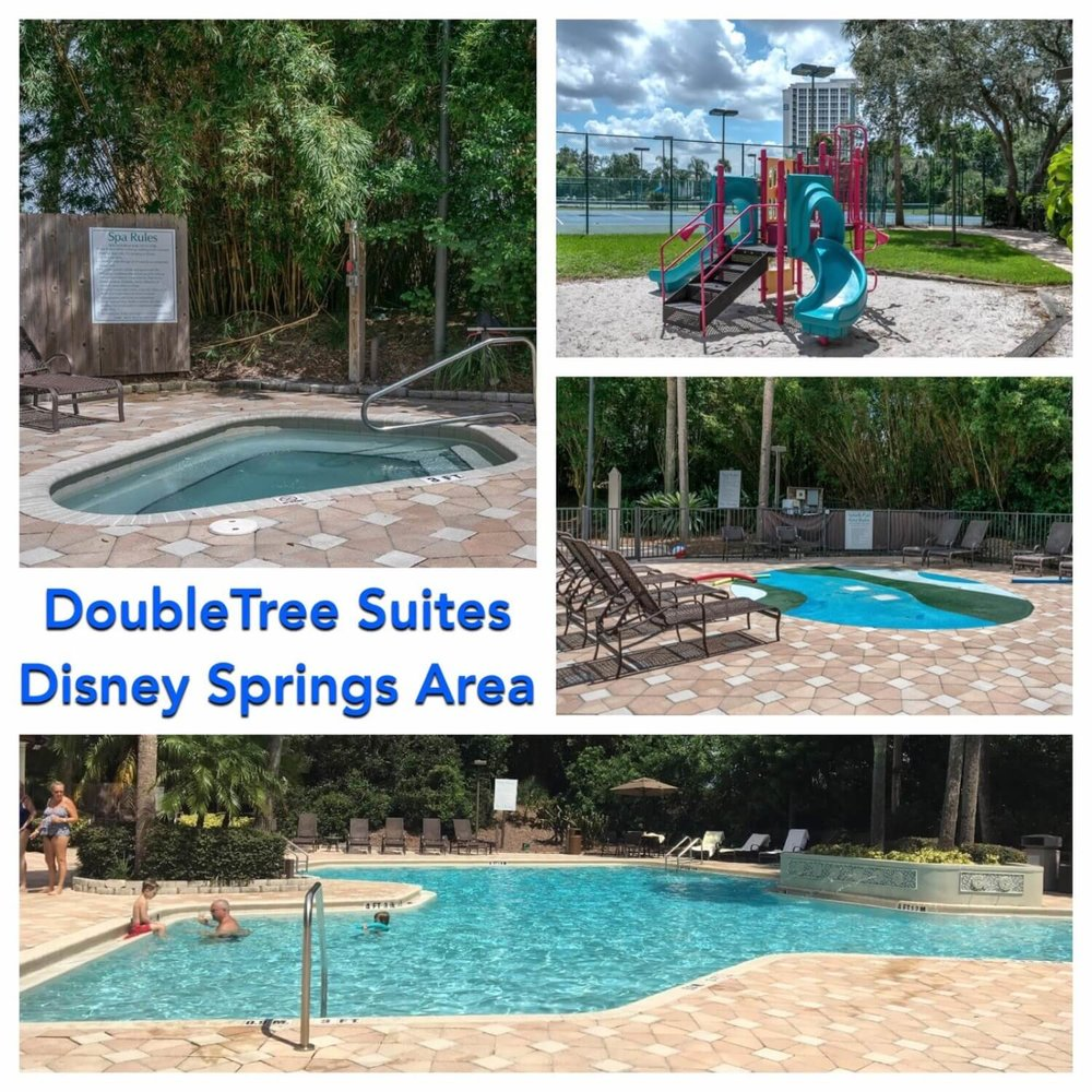Swimming pool and amenities at DoubleTree Suites by Hilton Orlando - Disney Springs: an official Good Neighbor hotel offering exclusive Walt Disney World Resort benefits.