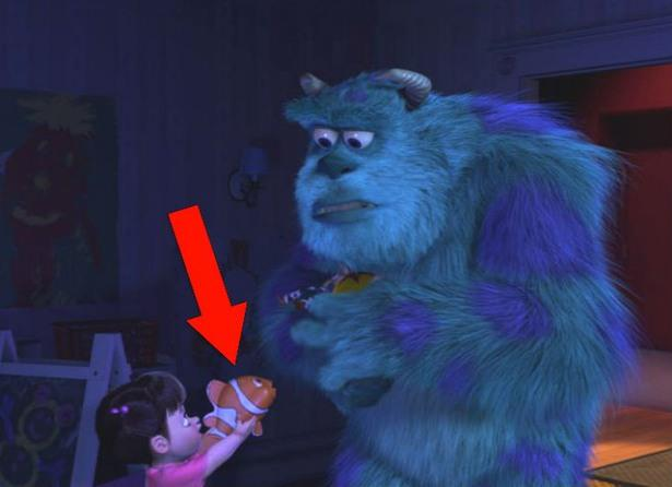 Boo holding a Finding Nemo toy in Monster's Inc.