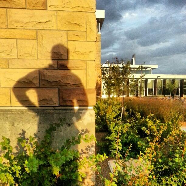 Sunset shadow portrait. #selfportrait #shadow #shadowportrait #visualartbuilding #universityofwyoming #wyoming #sunset  (Taken with  Instagram  at University of Wyoming)