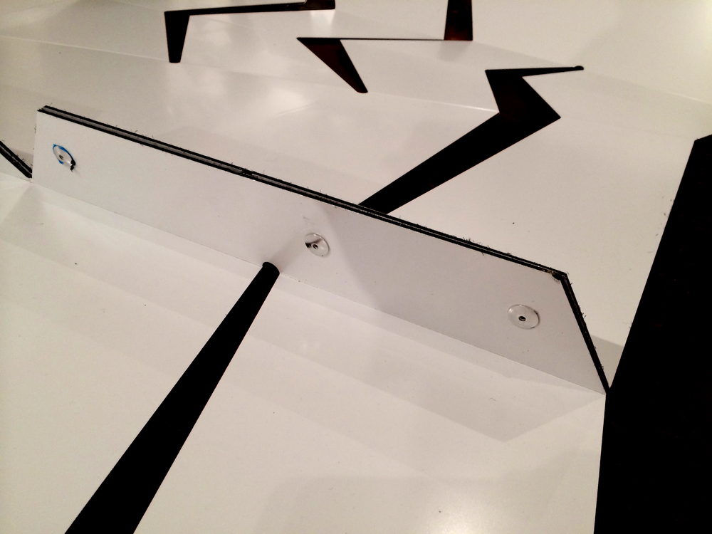 "The panels were fastened together with strategically designed 2"" tabs that allowed for a secure riveted connection without compromising the flexibility of the panelized surface."