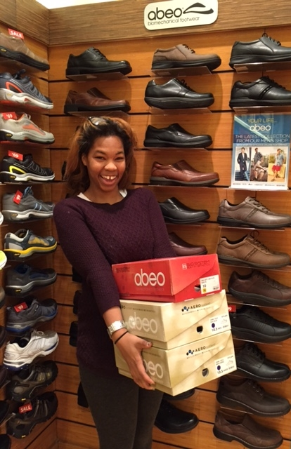 The Walking Company Sales Associate Pierre'ae with three pair of ABEO walking shoes purchased by We Get Around Chief Photographer Dan Smigrod at Lennox Square in Atlanta Sunday (15 February 2015).