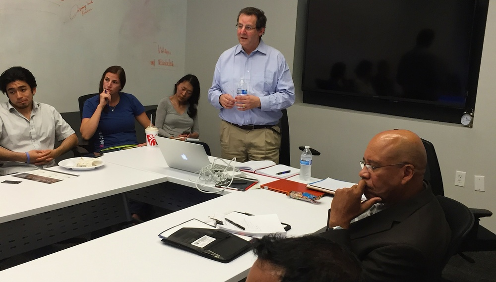 We Get Around Founder, CEO and Chief Photographer Dan Smigrod receives feedback at Pitch Practice at Atlanta Tech Village Friday, 12 June 2015 | Photo by Howard Medoff