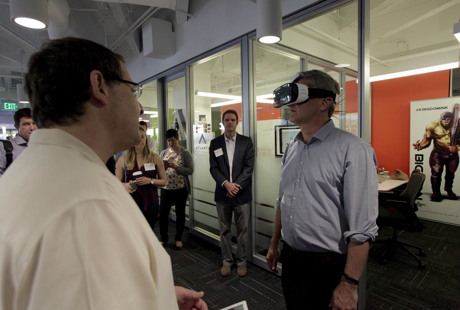 Photo: Steve Case receives a Matterport Virtual Reality (VR) demo by We Get Around Chief Photographer Dan Smigrod at its Atlanta Tech Village office Thursday, (7 May 2015). Village Founder David Cummings, appears in the back (center). Image courtesy of Andy Stoll