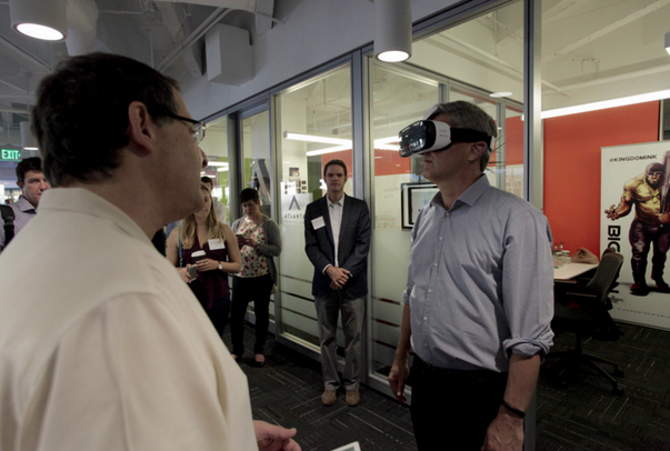 Photo: Steve Case receives a WalkAround™ Virtual Tour (VR) – powered by Matterport – from We Get Around Chief Photographer Dan Smigrod at its Atlanta Tech Village office Thursday, (7 May 2015). Village Founder David Cummings, appears in the back (center). Image courtesy of Andy Stoll