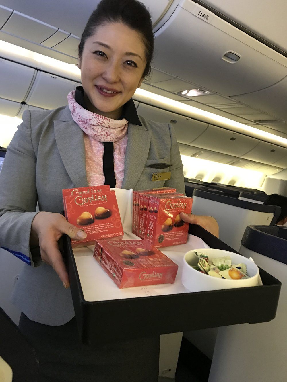 Photo: Party gift of artisanal Belgian chocolates presented by ANA Flight Attendant Ms. Ogasa. Image by We Get Around Chief Photographer Dan Smigrod.
