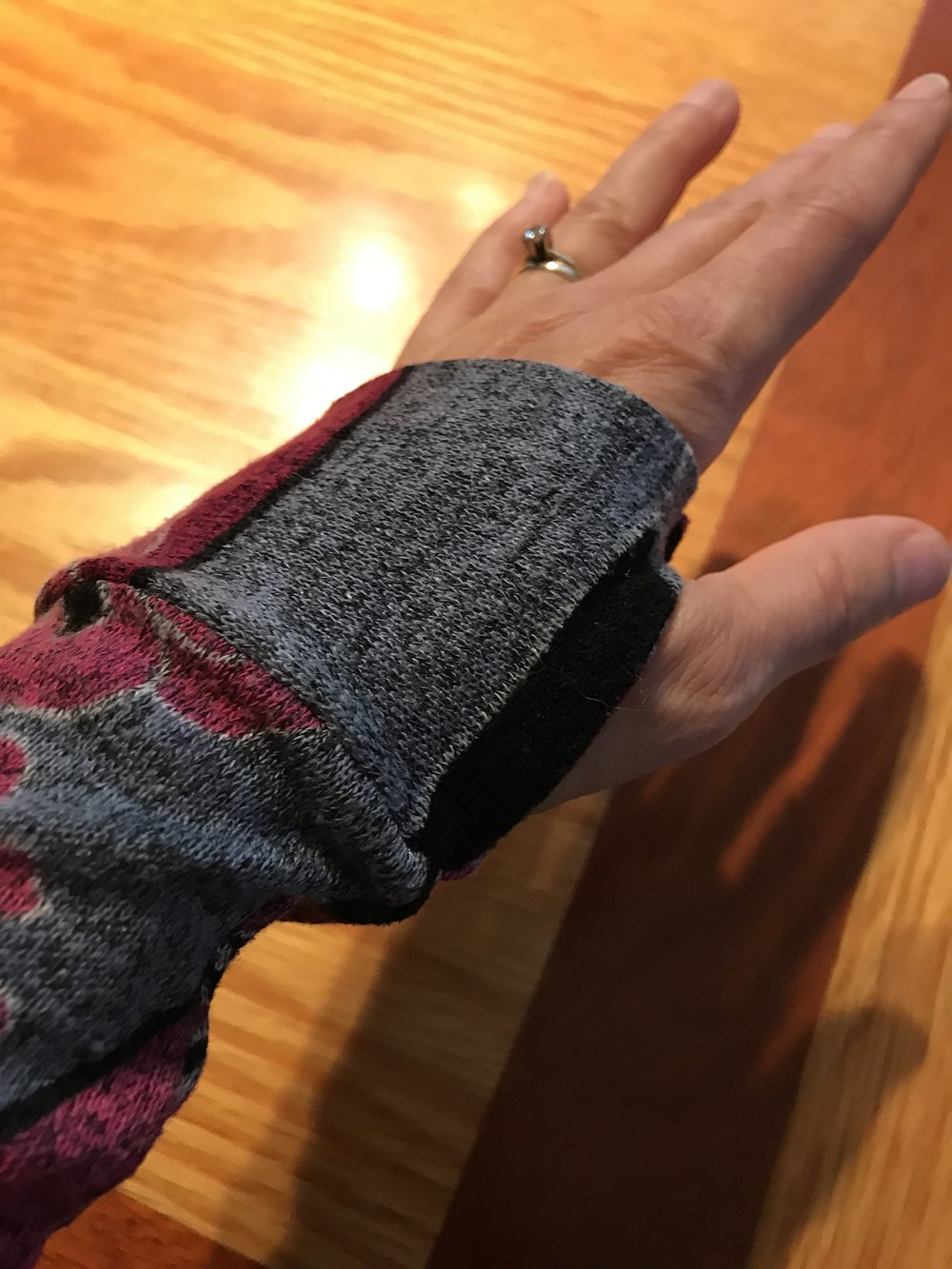 See this pretty cuff? It's easy to sew and offers your thumb more room to move than merely leaving space in the side seam for your thumb to emerge.