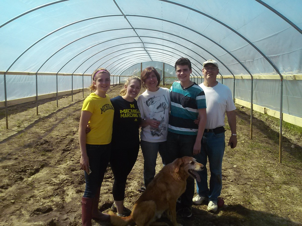 Cindy's Uncle Dave and cousin Christian Hines helped us get plastic on Hoop House # 2 in less than an hour