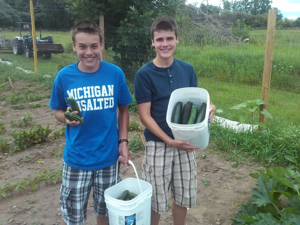 Nate and John with their zucchini harvest
