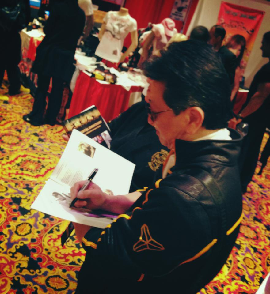 Sifu signing an autograph
