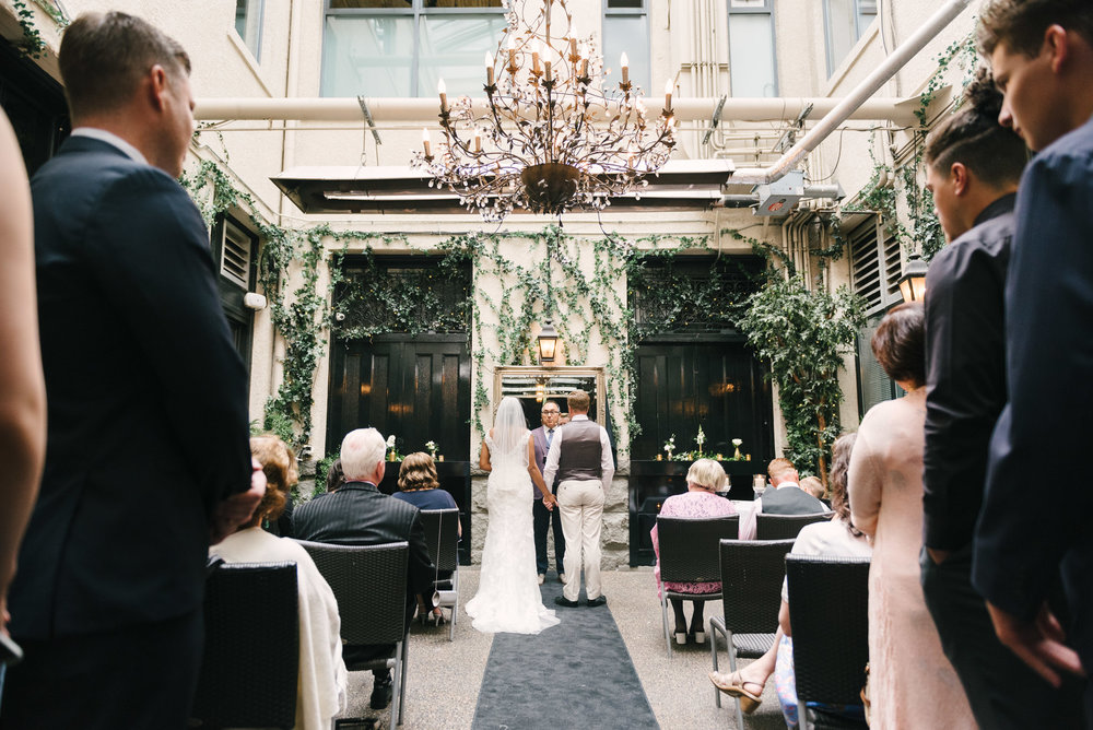 wedding ceremony at the brix and mortar restaurant courtyard