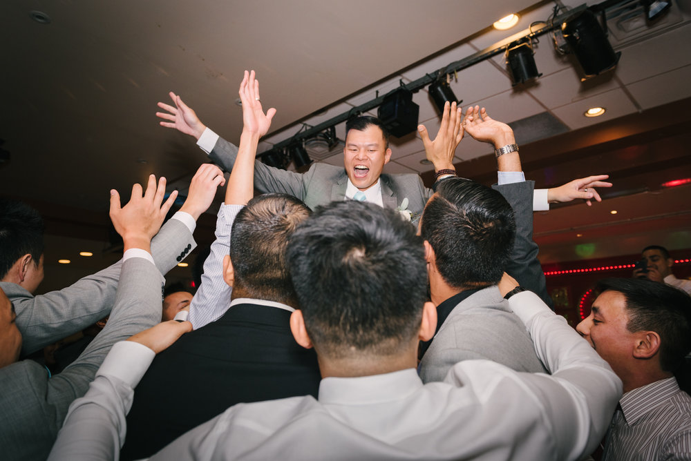 groom being lifted up during dancing