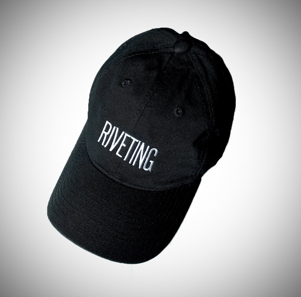 RIVETING DAD HAT   EMBROIDERED WHITE LOGO ON BLACK HAT.