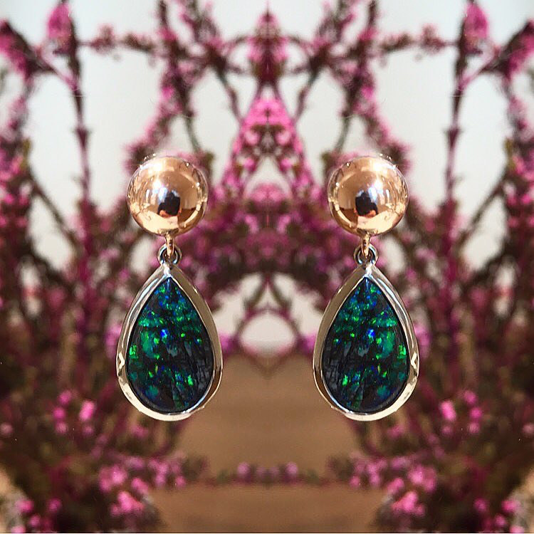Boulder Opal earrings - These gorgeous Australian Boulder Opals (7.10cts) from Bulgroo, Queensland have been beautifully set in 18ct white gold.I decided to keep the setting very simple because opals in my opinion have often been OVER designed!These beauties have been photographed with my detachable 9ct rose gold studs.... where each piece is sold separately.They have been designed so that you can change each component depending on your mood and energy that day. Come and play!SOLD - No longer available (studs are made to order)GALLERY HOURS:Monday-Friday 10am-5:30pm (Except Thurs till 7pm)Saturday 10am-4pm CLOSED Sunday