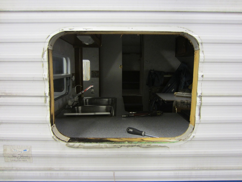 I removed all the windows from the RV so that we could take the sidings off. First surprise in the rear - a window frame is rotted.