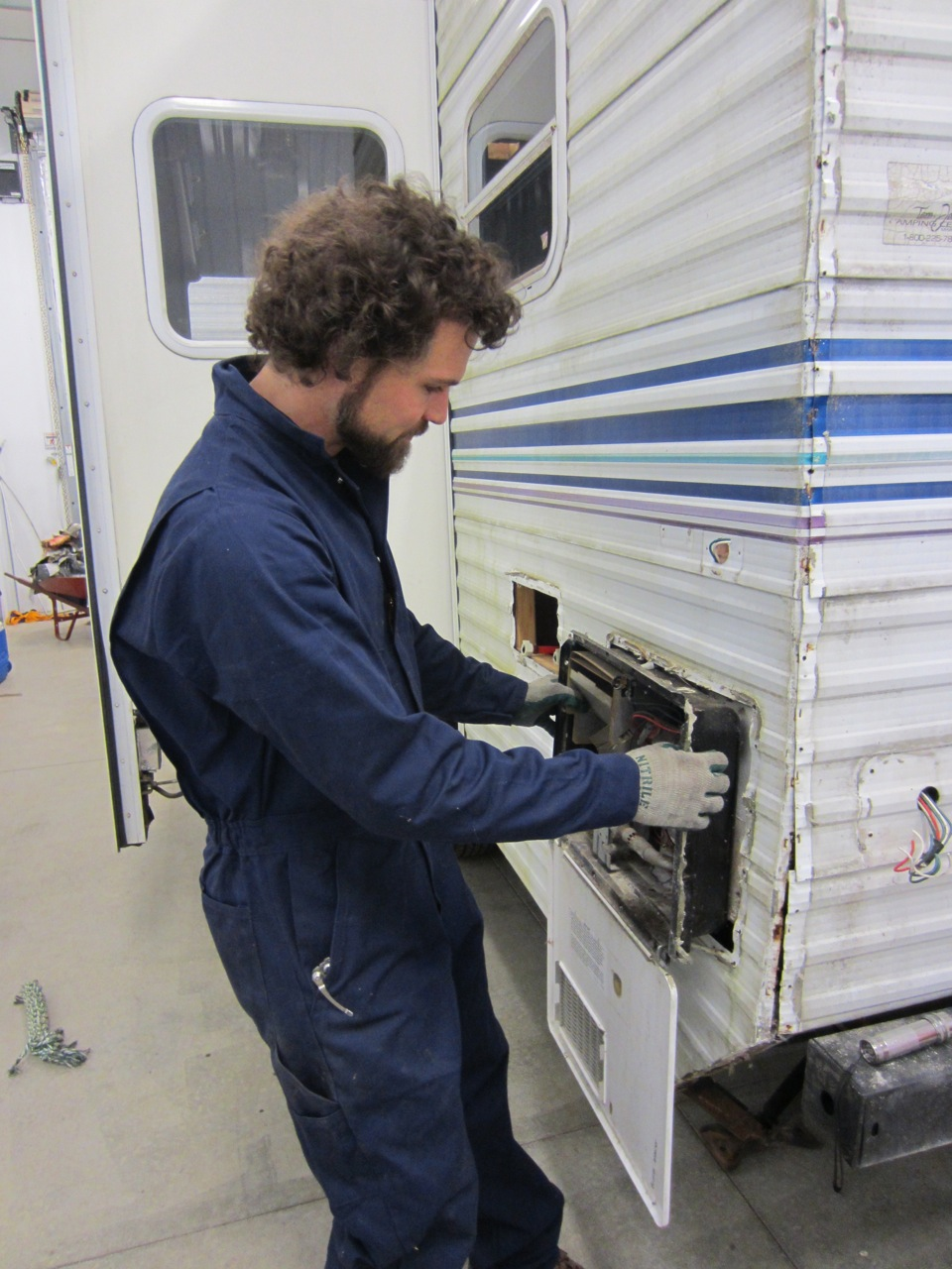 Jerud taking the water heater out. We won't be needing that - we are going to install point of use water heaters.