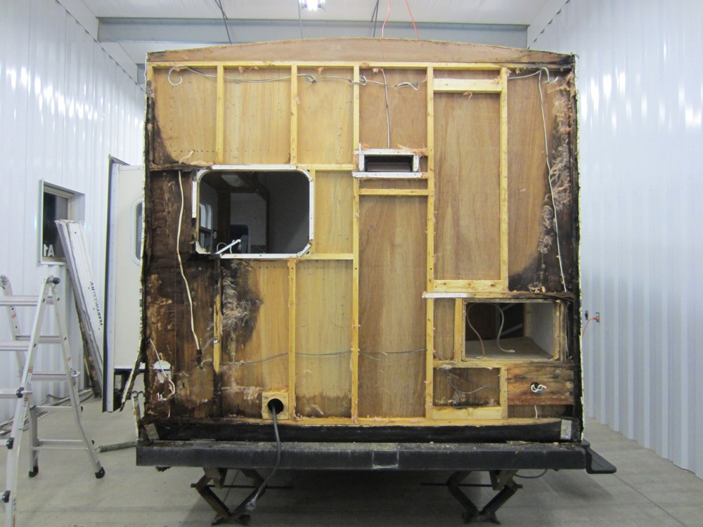 And THIS was our ugly surprise - the back of the RV  also  has water damage! View of the back with the insulation removed. All the black wood is rotted wood.