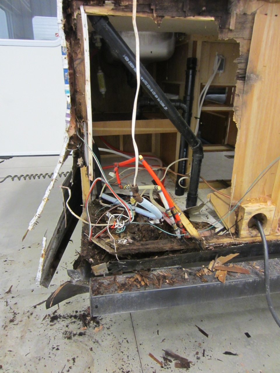Then to top that off, we realized that the floor where the water heater was sitting on was also rotted.