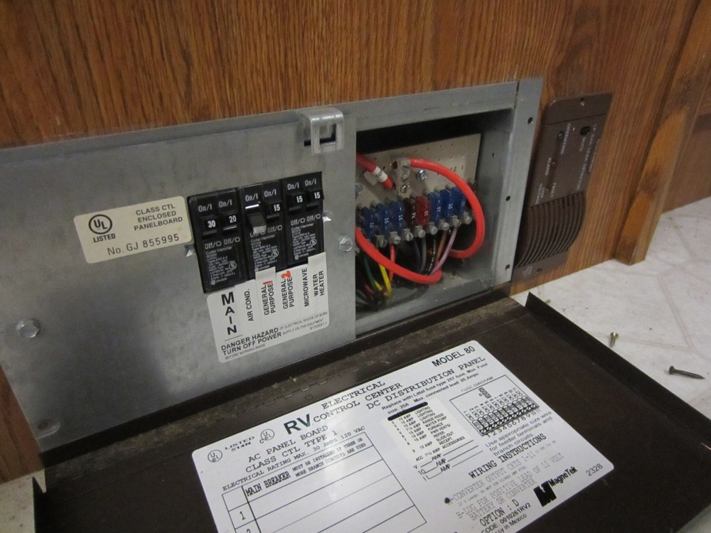 Removed the AC/DC distribution panel (shown), DC converter and battery charger.