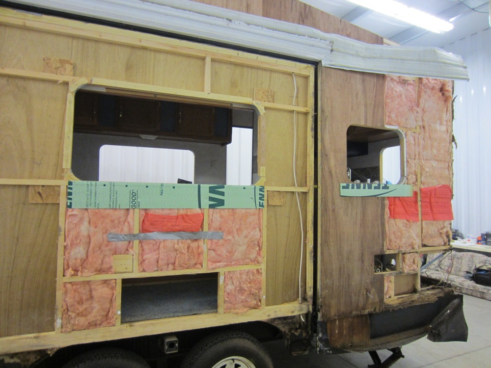All but one piece of siding is off. We also removed the insulation and packed up most of it in case it comes in handy later on (we are trying to reuse as much as we can). We're planning to upgrade to a new insulation that will insulate better (especially in the winter since RV aren't build for year-round living) and is more eco-friendly.