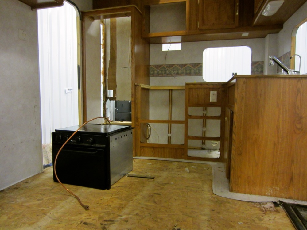 All the cabinets in the kitchen have to come out since we have to rebuild the walls back there.