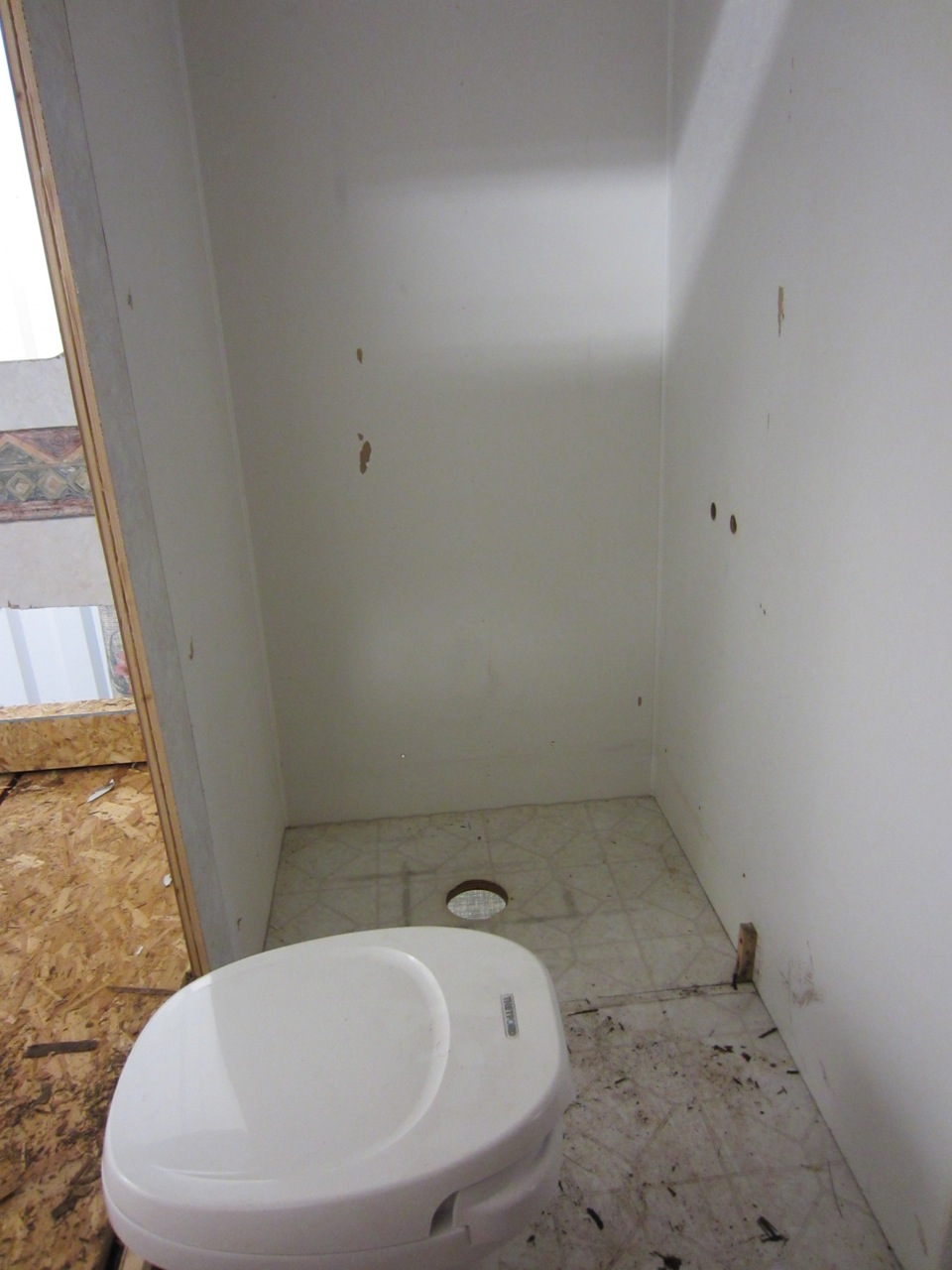 Shower is out too! We're going to put in a corner shower to increase space in the bedroom and in the shower.