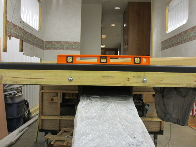 The very front of the trailer was easy to do because the holes in the chassis were evenly placed so putting holes in the wood board was quick.