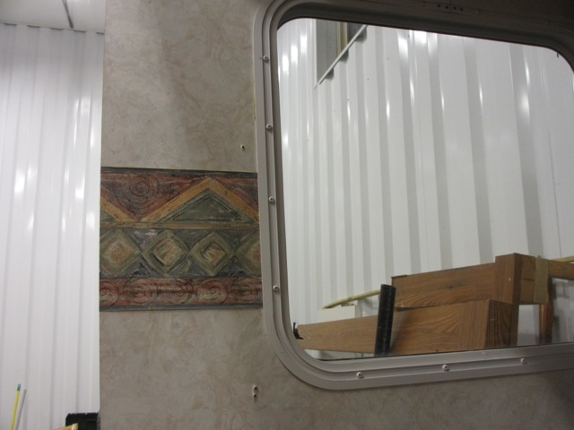 In the middle of the interior RV walls is a strip of hideous wallpaper. We're eventually going to paint over the walls but we can't leave the wallpaper because it doesn't sit flush on the wall.