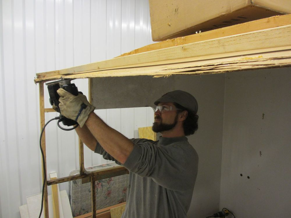 Clean up the roof by cutting the luan into a straight piece using the