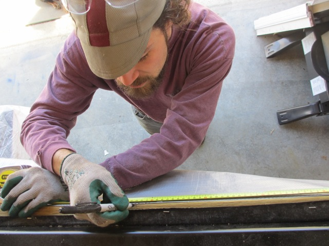 Jerud measuring where the studs will sit against the sill plate.