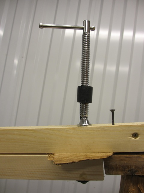 We put a sample piece of luan in between the two studs so we knew how much to tighten them.