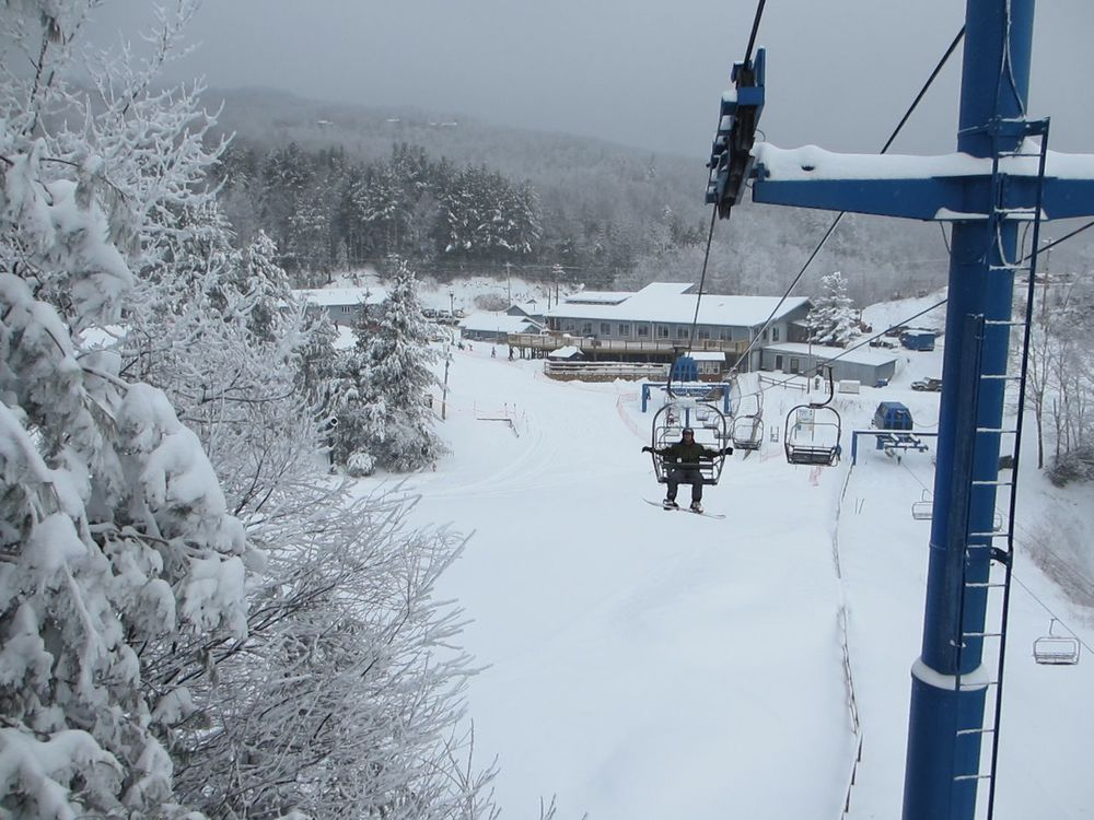 That's the ski lodge in the background. No hotels, no condos, nothing but that and some lifts. Simple.