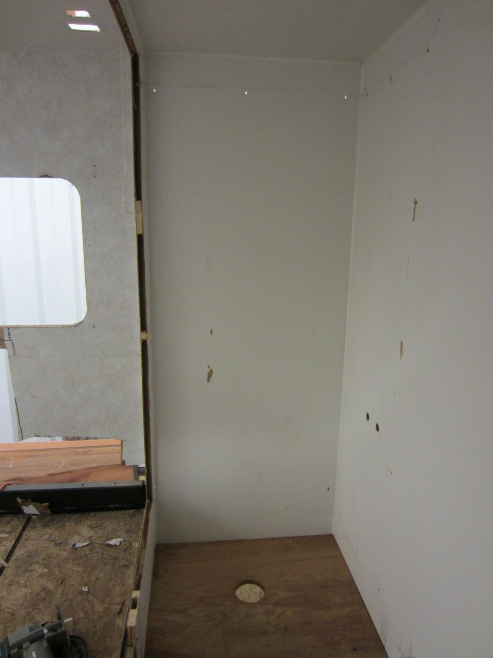 The wall in the previous picture used to be here, to the right of the window, separating the bedroom from the shower.