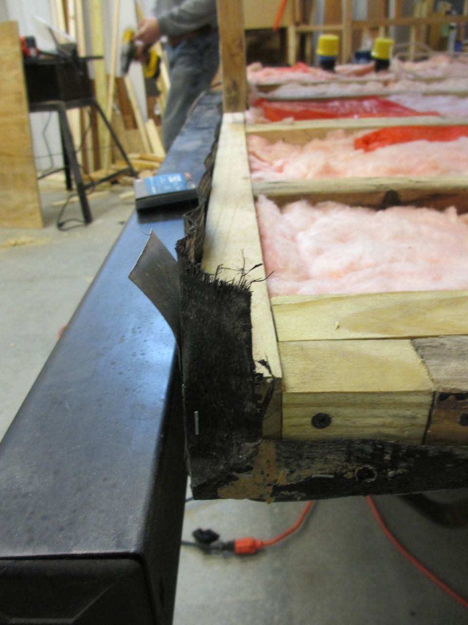 We stapled the underbelly wrap to get the beams ready for the sub-floor.